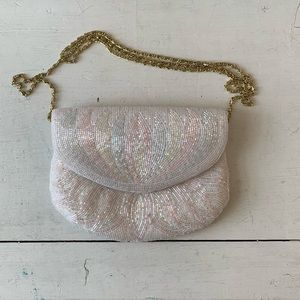 La Regale white beaded evening bag with gold chain